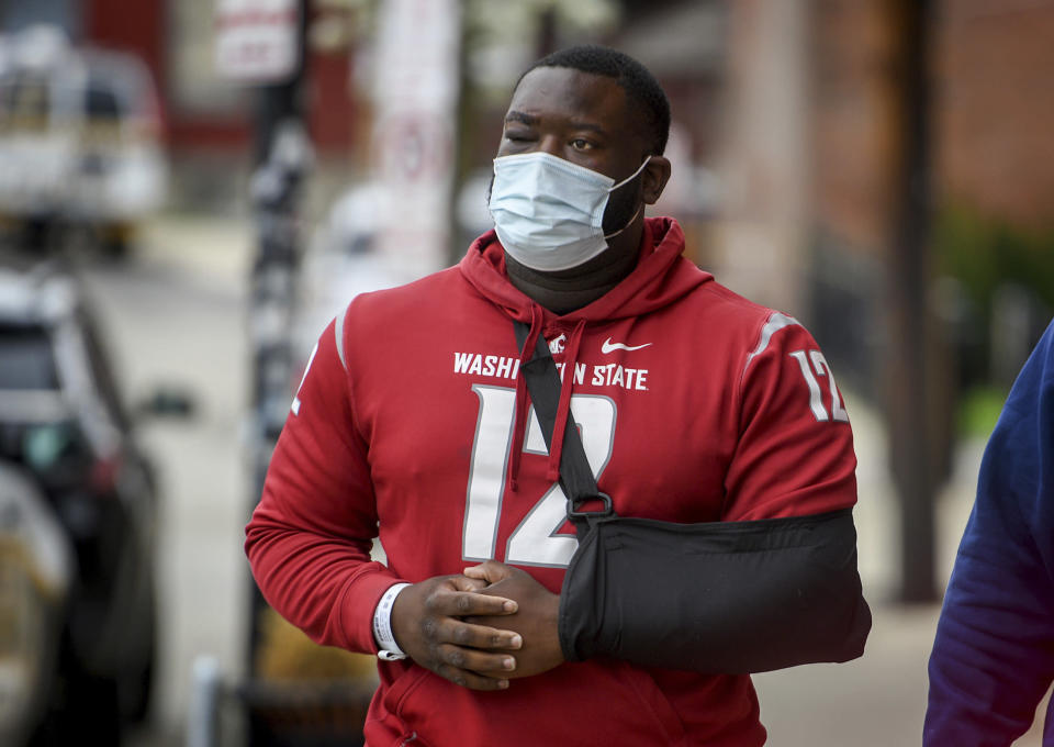 De'Vincent Spriggs walks outside of the Pittsburgh Police Zone 3 station on Wednesday, April 14, 2021, in Pittsburgh. Spriggs told Pittsburgh police Wednesday that Los Angeles Rams defensive lineman Aaron Donald and others assaulted the him at a nightclub last weekend, causing multiple injuries. (Steve Mellon/Pittsburgh Post-Gazette via AP)