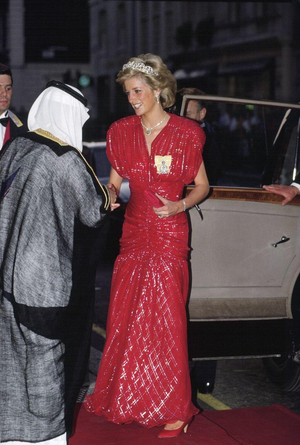 <p>Diana wore this head-to-toe red sparky gown with the Spencer tiara to a banquet held at Claridges in London. The dress was designed by Bruce Oldfield.</p>