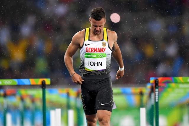 <p>Alexander John of Germany reacts after being disqualified as rain falls following the Men's 110m Hurdles Round 1 – Heat 1 on Day 10 of the Rio 2016 Olympic Games at the Olympic Stadium on August 15, 2016 in Rio de Janeiro, Brazil. (Getty) </p>