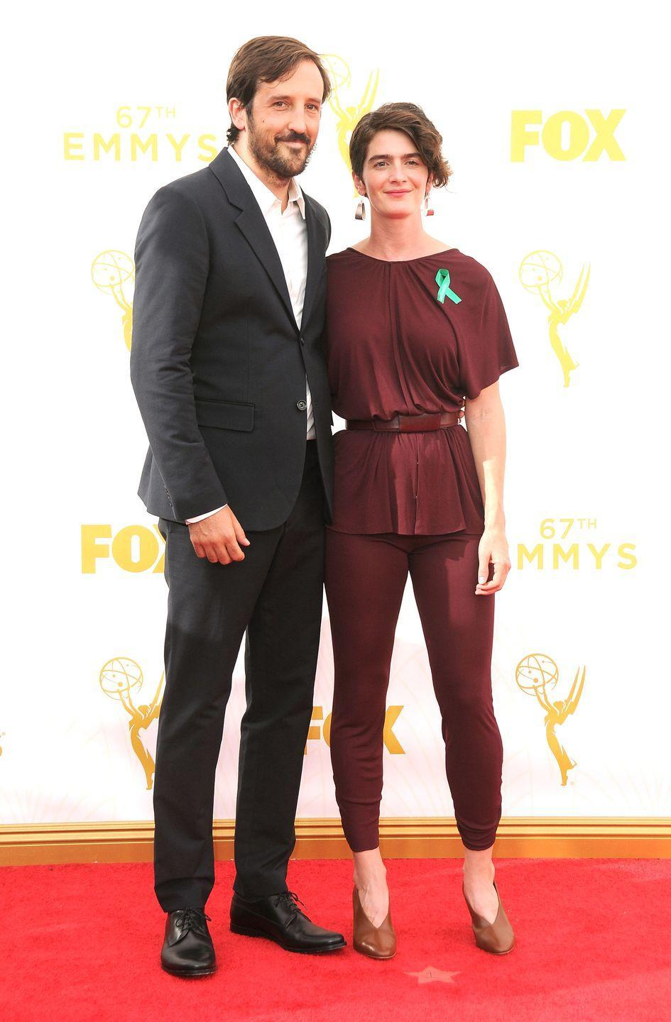 <p>Hoffmann looked stunning in a burgundy ensemble at the 2015 Emmy Awards.</p>