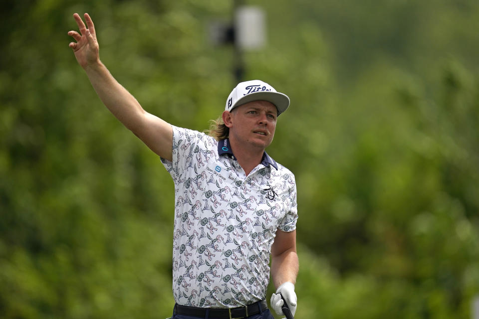 Cameron Smith of Australia follows his shot off the second tee during the third round of the PGA Zurich Classic golf tournament at TPC Louisiana in Avondale, La., Saturday, April 24, 2021. (AP Photo/Gerald Herbert)