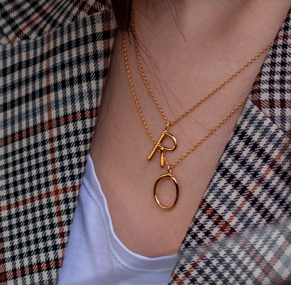 "<br><br><strong>Wonther</strong> Initial Necklace, $, available at <a href=""https://go.skimresources.com/?id=30283X879131&url=https%3A%2F%2Fwww.wolfandbadger.com%2Fus%2Finitial-r-necklace%2F"" rel=""nofollow noopener"" target=""_blank"" data-ylk=""slk:Wolf & Badger"" class=""link rapid-noclick-resp"">Wolf & Badger</a>"