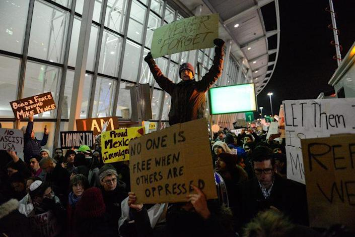 Protesters rally against the new immigration ban issued by President Trump at John F. Kennedy International Airport in New York City Saturday night. (Photo: Stephanie Keith/Getty Images)