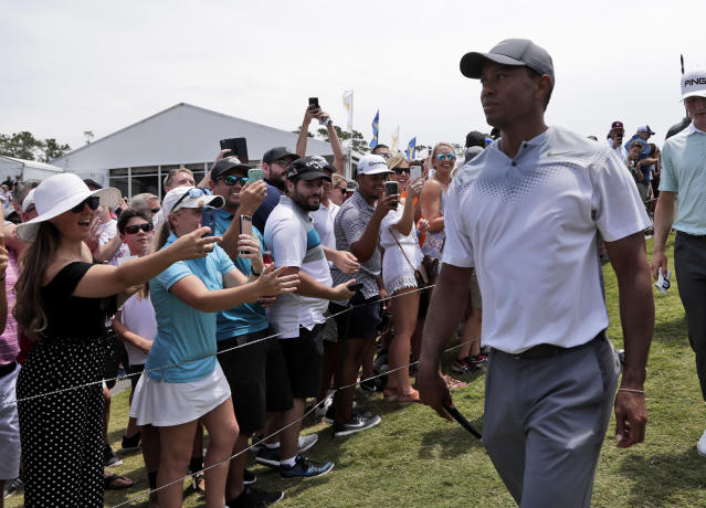 Tiger Woods walks off the 18th hole during the third round of the Players Championship golf tournament. (AP)