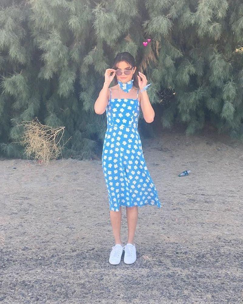 <p>In an HVN dress and Alain Mikli sunglasses at Coachella 2017.</p>
