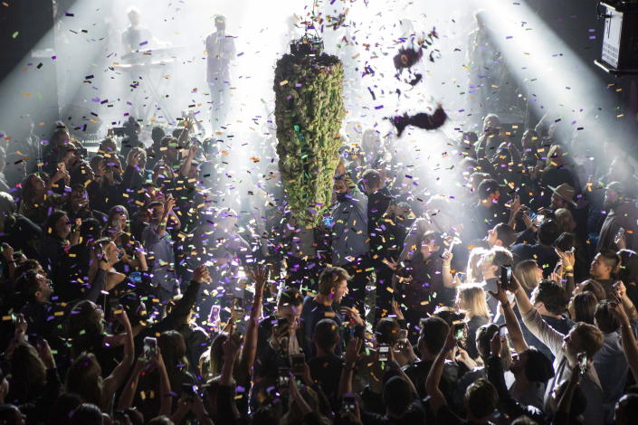 <p>A depiction of a cannabis bud drops from the ceiling at Leafly's countdown party in Toronto on Wednesday, Oct. 17, 2018, as midnight passes and marks the first day of the legalization of cannabis across Canada. (Photo: Chris Young/The Canadian Press via AP) </p>