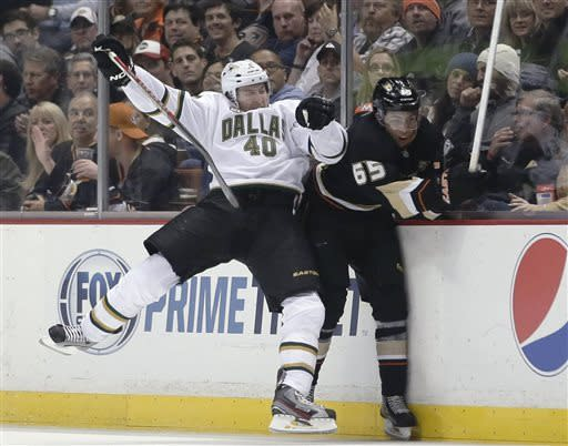 Dallas Stars' Ryan Garbutt, left, checks Anaheim Ducks' Emerson Etem during the second period of an NHL hockey game in Anaheim, Calif., Wednesday, April 3, 2013. (AP Photo/Jae C. Hong)