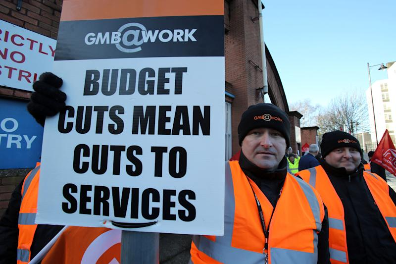 Workers protest outside the Great Victoria street Rail and Bus depot in Belfast, as tens of thousands of public service workers were taking part in the 24 action over Stormont spending cuts.