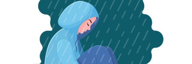 An illustration of a woman sitting under a cloud in the rain with a hood over her head.