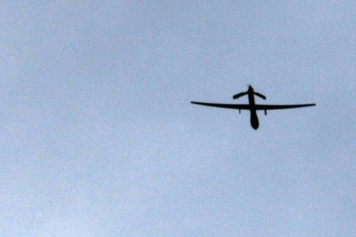 """File photo of a US """"Predator"""" drone passing over Kandahar, Afghanistan. A major salvo of US missiles on Wednesday destroyed a Pakistani Taliban base on the Afghan border, killing up to 18 militants including possible Al-Qaeda fighters, local officials said"""