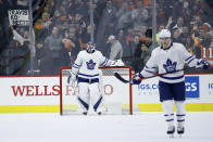 Toronto Maple Leafs' Frederik Andersen, center, reacts after giving up a goal to Philadelphia Flyers' Travis Konecny during the third period of an NHL hockey game, Tuesday, Dec. 3, 2019, in Philadelphia. (AP Photo/Matt Slocum)