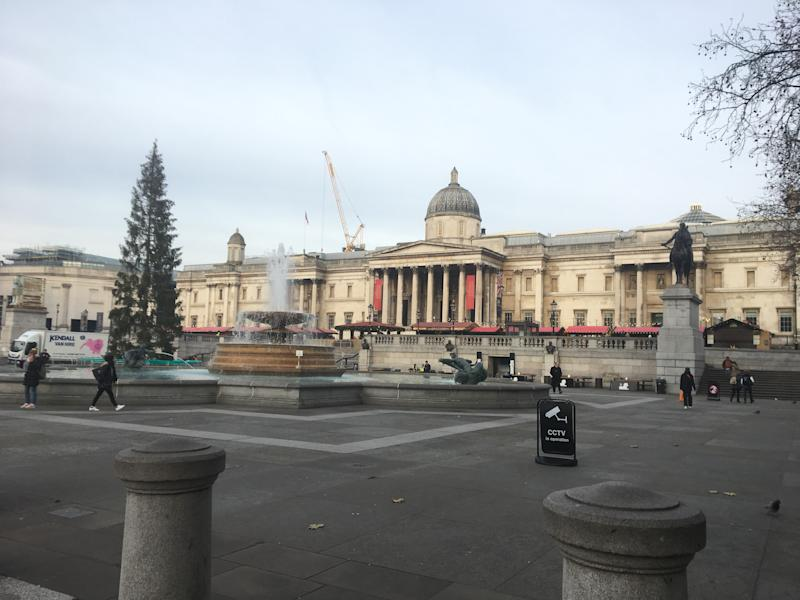 Trafalgar Square with the Christmas market by the gallery.