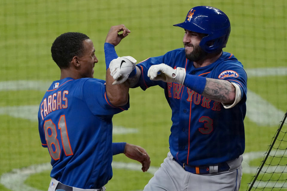 New York Mets' Tomas Nido (3) celebrates with Johneshwy Fargas after hitting a solo home run during the ninth inning of the team's baseball game against the Atlanta Braves on Tuesday, May 18, 2021, in Atlanta. (AP Photo/John Bazemore)