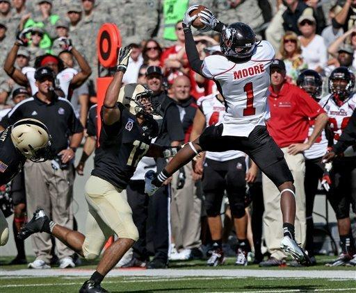 Northern Illinois' Martel Moore catches a pass over Army's Tyler Dickson on a drive that lead to the winning touchdown late in the second half in an NCAA college football game in West Point, N.Y., on Saturday, Sept. 15, 2012. Nothern Illinois won 41-40. (AP Photo/Craig Ruttle)