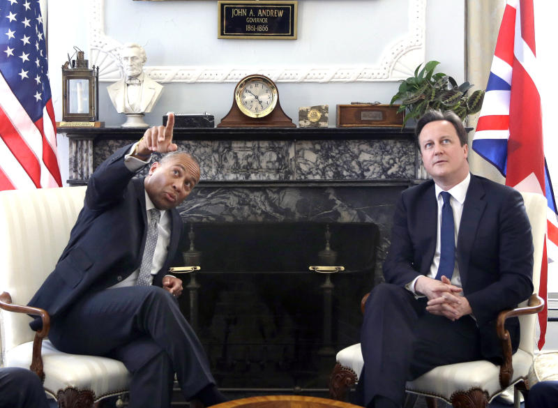 Mass. Gov. Deval Patrick points out something of interest to British Prime Minister David Cameron in the Governor's Office at the Statehouse in Boston, Monday, May 13, 2013. Cameron arrived in the U.S. on Monday. (AP Photo/Elise Amendola)