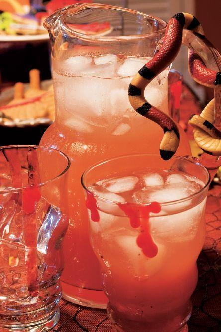 """<p>Pomegranate juice, lemonade, lemon-lime soda, and red dye come together to make this ghoulish-looking drink.</p><p><a href=""""https://www.womansday.com/food-recipes/food-drinks/a28859886/witchs-potion-recipe/"""" rel=""""nofollow noopener"""" target=""""_blank"""" data-ylk=""""slk:Get the recipe for Witch's Potion."""" class=""""link rapid-noclick-resp""""><em>Get the recipe for Witch's Potion.</em></a></p>"""
