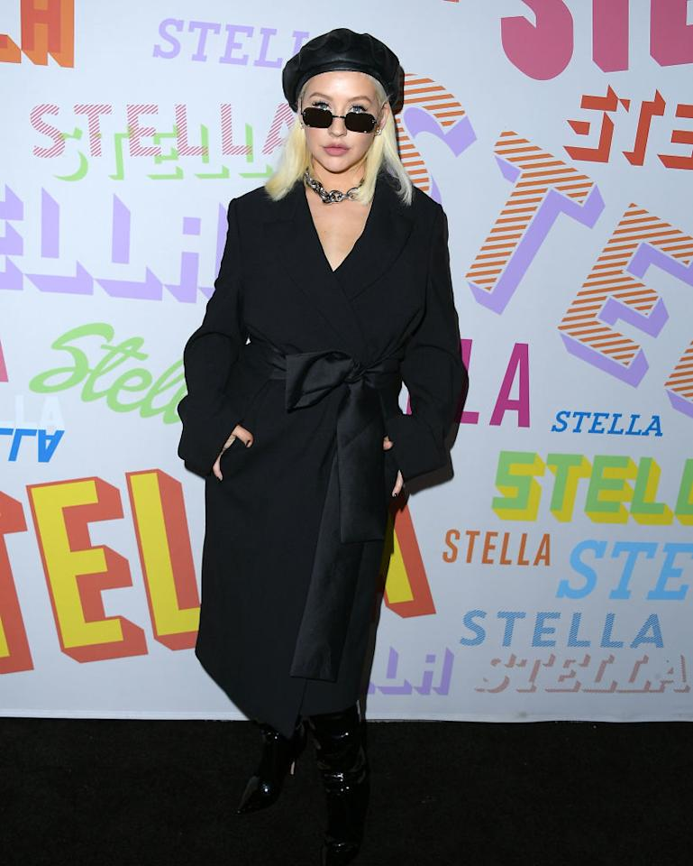 <p>Christina Aguilera went incognito in an all-black aesthetic accessorised with this season's two most sought after must-haves, the leather beret and Matrix-inspired lenses. <em>[Photo: Getty]</em> </p>