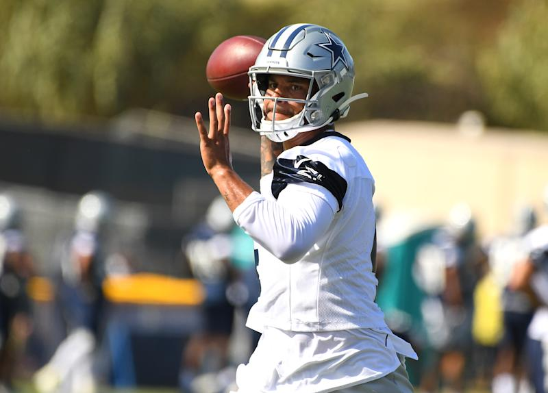 OXNARD, CA - JULY 28: Quarterback Dak Prescott #4 of the Dallas Cowboys looks to make a pass during training camp drills on July 28, 2019 in Oxnard, California. (Photo by Jayne Kamin-Oncea/Getty Images)