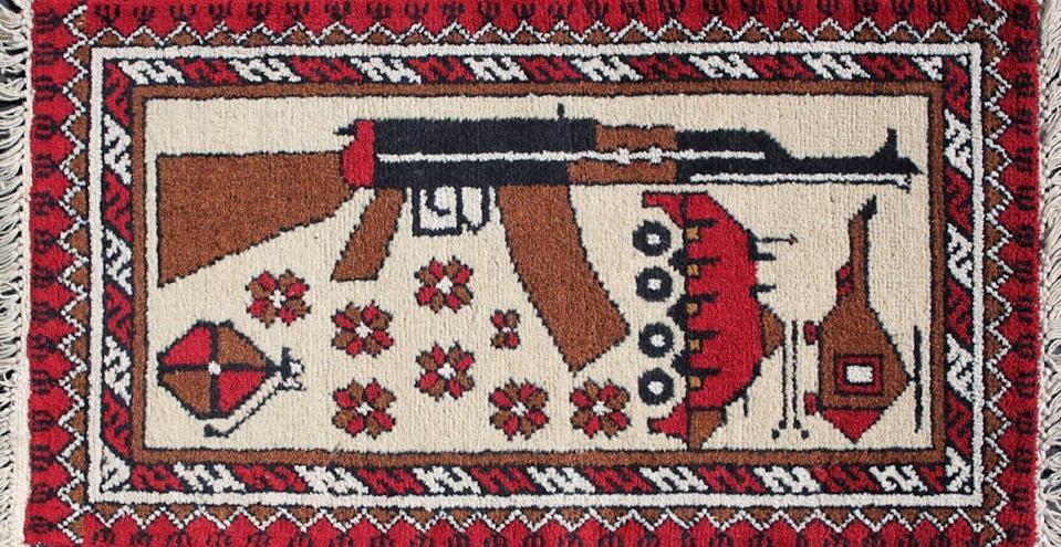 """<span class=""""caption"""">The rug designs tend to contain symbols – AK-47s, 9/11 and drones – that reflect an outsider's understanding of war.</span> <span class=""""attribution""""><span class=""""source"""">Kevin Sudeith, courtesy of WarRug.com</span>, <a class=""""link rapid-noclick-resp"""" href=""""http://creativecommons.org/licenses/by-sa/4.0/"""" rel=""""nofollow noopener"""" target=""""_blank"""" data-ylk=""""slk:CC BY-SA"""">CC BY-SA</a></span>"""