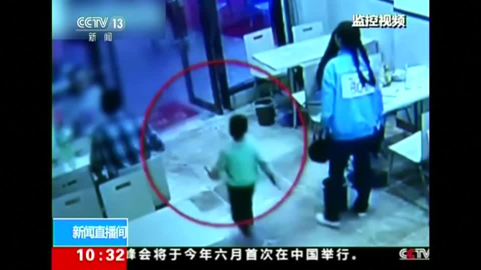A pregnant Chinese woman trips a 4-year-old boy in a restaurant on purpose. No reporter narration.