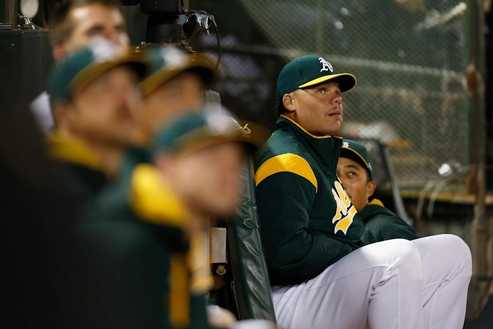Bruce Maxwell sits in the dugout during the game against the Texas Rangers at Oakland Alameda Coliseum on September 23, 2017 in Oakland, California. (Getty Images)