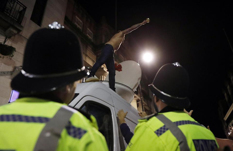 Britain Football Soccer - Leicester City fans watch the Chelsea v Tottenham Hotspur game in pub in Leicester - 2/5/16 A Leicester City fans celebrate winning the Premier League on a van as Police officers look on Reuters / Eddie Keogh Livepic