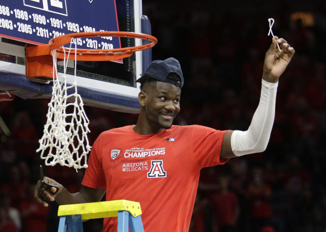 Arizona forward Deandre Ayton (13) cuts down the net after winning the Pac-12 title after an NCAA college basketball game against California, Saturday, March 3, 2018, in Tucson, Ariz. Arizona defeated California 66-54. (AP Photo/Rick Scuteri)