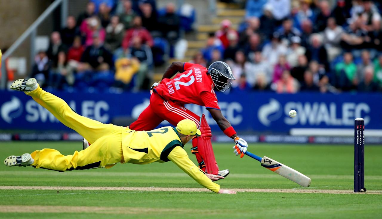 England's Michael Carberry survives a run out attempt by Australia's George Bailey during the fourth one day international at the SWALEC Stadium, Cardiff.