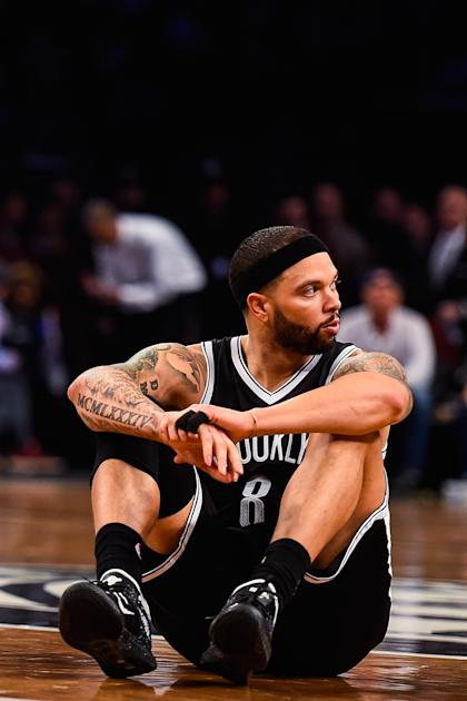 NEW YORK, NY - APRIL 25: Deron Williams #8 of the Brooklyn Nets looks on during the first round of the 2015 NBA Playoffs against the Atlanta Hawks at Barclays Center on April 25, 2015 in the Brooklyn borough of New York City. NOTE TO USER: User expressly acknowledges and agrees that, by downloading and/or using this photograph, user is consenting to the terms and conditions of the Getty Images License Agreement. (Photo by Alex Goodlett/Getty Images)