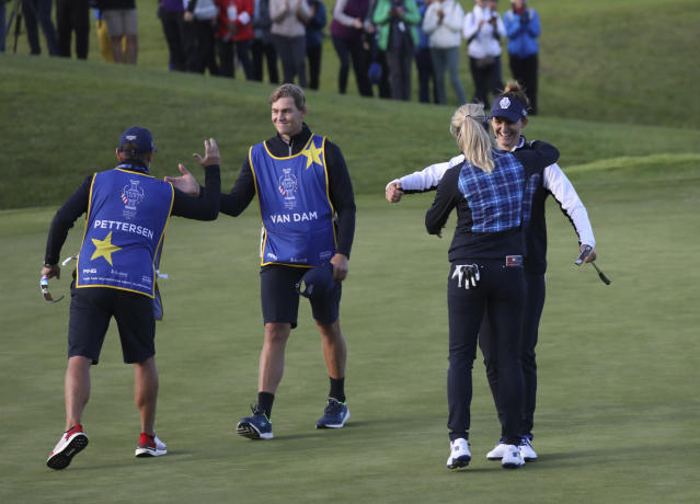 Suzann Pettersen and Anne Van Dam, right, celebrate after their victory against the US during the Fourballs match in the Solheim cup at Gleneagles, Auchterarder, Scotland, Friday, Sept. 13, 2019. (AP Photo/Peter Morrison)