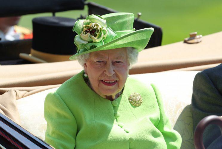 <i>The Queen went for an eye-catching shade of green once again [Photo: PA]</i>