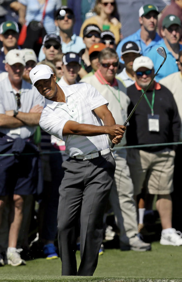 Tiger Woods takes his third shot on the second hole during the third round of the Masters golf tournament Saturday, April 7, 2012, in Augusta, Ga. (AP Photo/David J. Phillip)