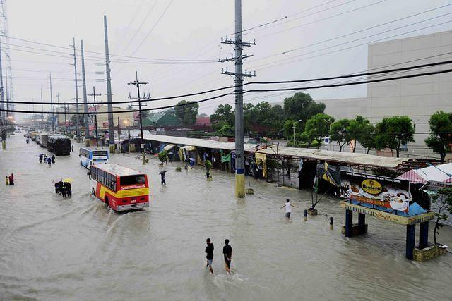 Vehicles try to pass through the flooded Aguinaldo Highway in Bacoor, Cavite Province, south of Manila, on 07 August 2012. The Habagat (southwest monsoon) continues to bring scattered rain showers that caused flood in some parts of Cavite. (Angela Galia, NPPA images)