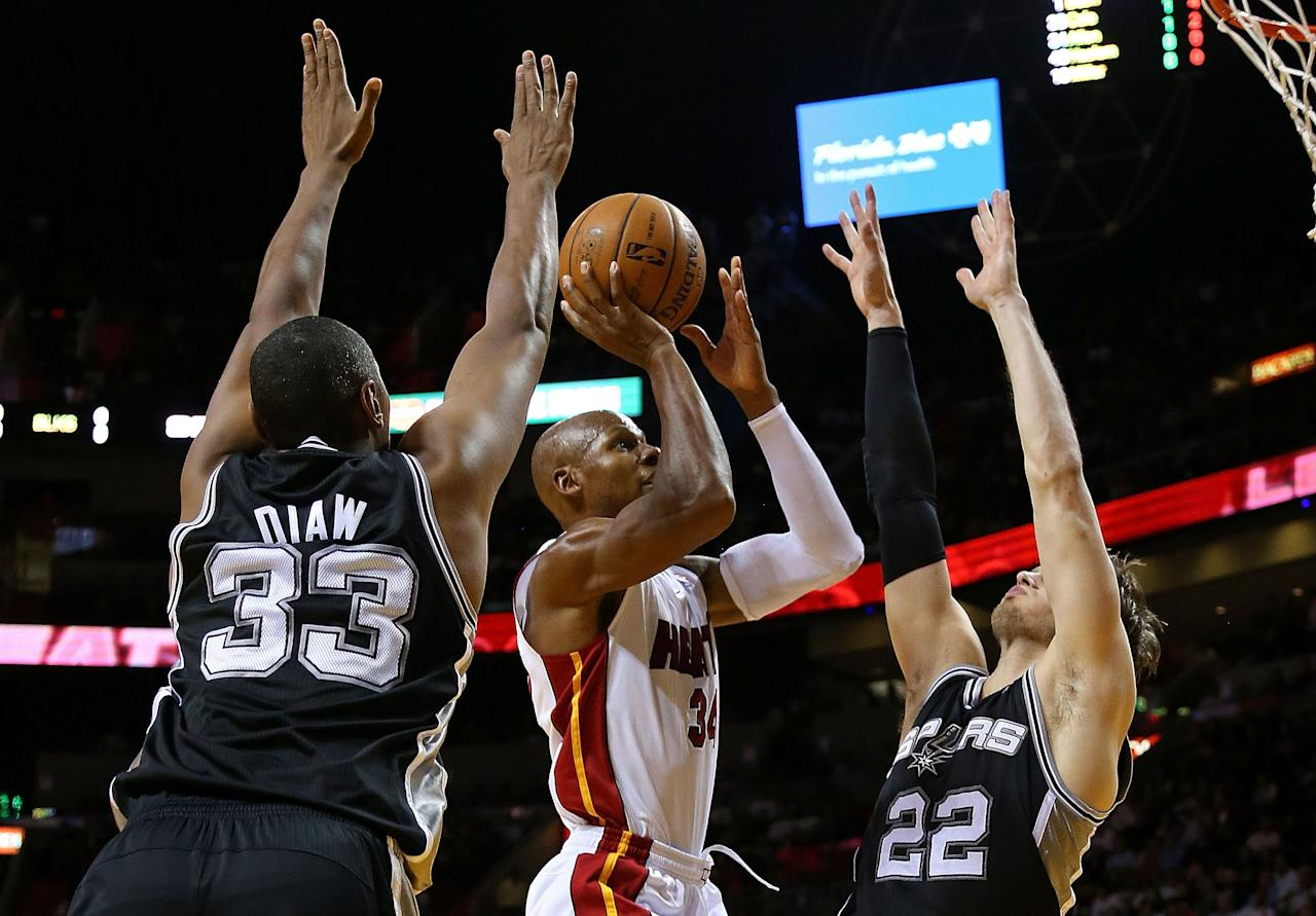 MIAMI, FL - NOVEMBER 29: Ray Allen #34 of the Miami Heat shoots over Tiago Splitter #22 of the San Antonio Spurs during a game  at American Airlines Arena on November 29, 2012 in Miami, Florida.  (Photo by Mike Ehrmann/Getty Images)