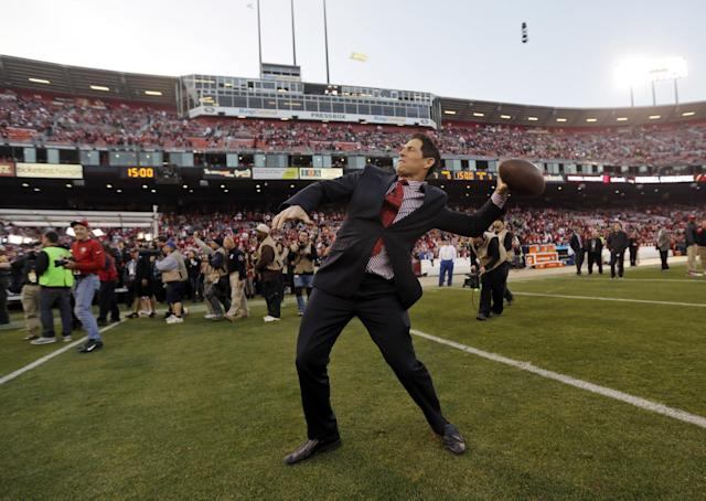 Former San Francisco 49ers quarterback Steve Young throws a ball on the field at Candlestick Park before the 49ers' NFL football game against the Atlanta Falcons in San Francisco, Monday, Dec. 23, 2013. The 49ers are playing their last regular-season game at Candlestick before moving a new stadium for the 2014 season. (AP Photo/Marcio Jose Sanchez)