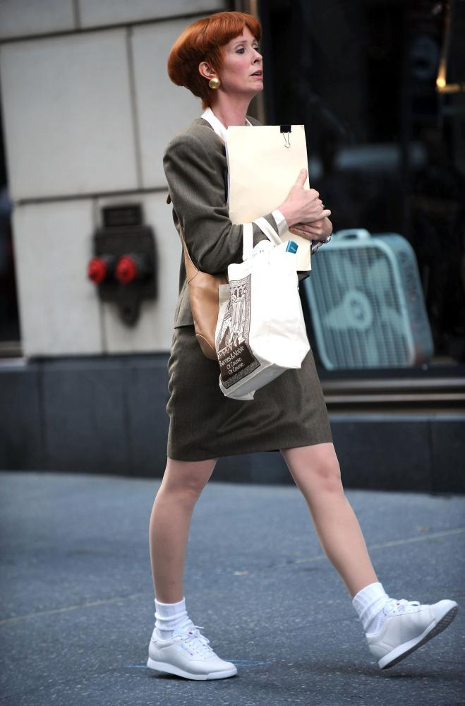 Cynthia Nixon as Miranda Hobbes wears 'commuter shoes', in Sex and the City 2.
