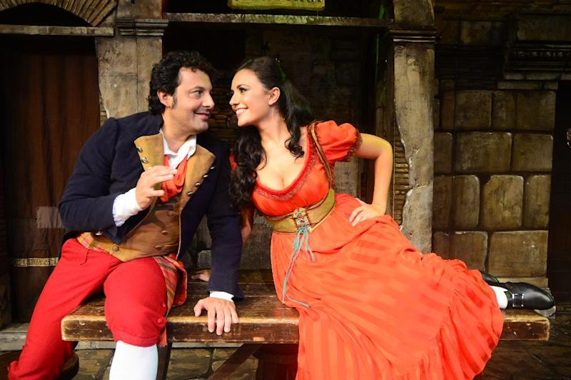 "This undated image released by Michelle Tabnick Communications shows Italian comedian Enrico Brignano, left, and actress Serena Rossi in character from ""Rugantino,"" one of Italy's most successful musicals. Producers said Monday, March 17, 2014, that the production celebrating the show's 50th anniversary of its Broadway debut will play New York City Center this June starring Italian comedian Enrico Brignano. (AP Photo/Michelle Tabnick Communications)"