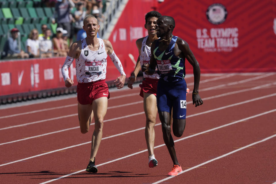 Paul Chelimo celebrates after beating Grant Fisher and Woody Kincaid in the finals of men's 5000-meter run at the U.S. Olympic Track and Field Trials Sunday, June 27, 2021, in Eugene, Ore. (AP Photo/Ashley Landis)