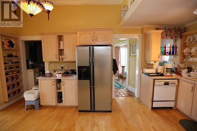 <p><span>1 Bonaventure Ave., St. John's, Nfld.</span><br> The kitchen has a cooktop, dishwasher and built-in oven.<br> (Photo: Zoocasa) </p>