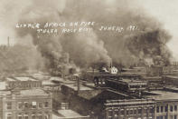 This photo provided by the Department of Special Collections, McFarlin Library, The University of Tulsa shows fires burning during the Tulsa Race Massacre in Tulsa, Okla., on June 1, 1921. (Department of Special Collections, McFarlin Library, The University of Tulsa via AP)