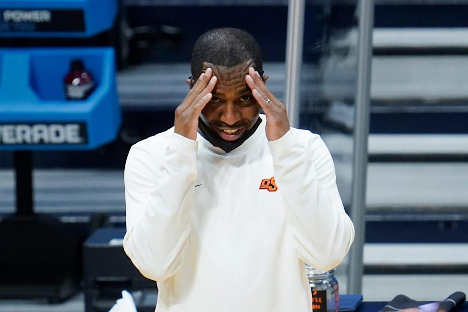 Oklahoma State head coach Mike Boynton reacts to a play against Oregon State during the second half in the second round of the NCAA Tournament.