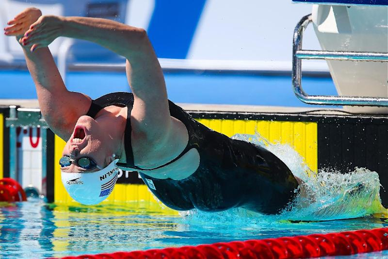 Swimming - Franklin battles back injury in Pan Pac heats