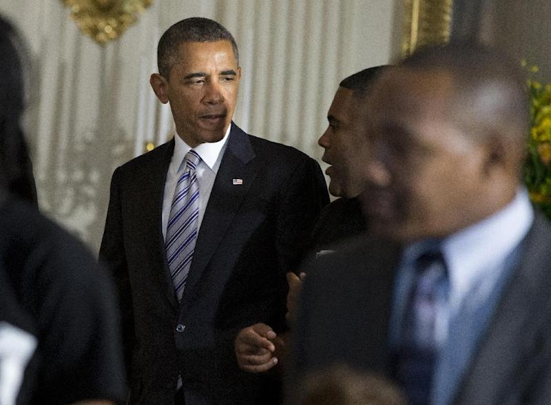 """President Barack Obama mingles in the State Dining Room of the White House in Washington, Friday, June 14, 2013, where he hosted a Father's Day luncheon. Speaking about Syria, the president said the use of chemical weapons in Syria crosses a """"red line,"""" triggering greater U.S involvement in the crisis. (AP Photo/Evan Vucci)"""