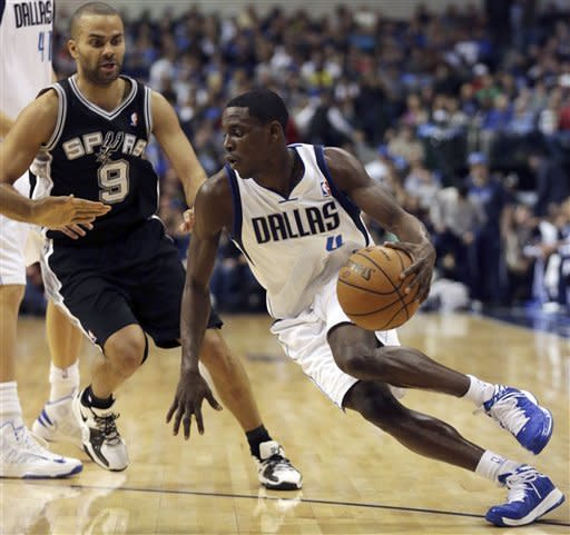 Dallas Mavericks guard Darren Collison (4) drives against San Antonio Spurs guard Tony Parker (9), of France, during the first half of an NBA basketball game in Dallas on Sunday, Dec. 30, 2012. (AP Photo/Mike Fuentes)