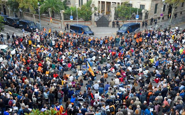 Demonstrators blockaded the office of the Spanish government's delegation in Barcelona after it was widely reported the prime minister was to attend a meeting there - AFP