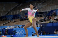 Rebeca Andrade, of Brazil, performs on the floor during the artistic gymnastics women's apparatus final at the 2020 Summer Olympics, Monday, Aug. 2, 2021, in Tokyo, Japan. (AP Photo/Ashley Landis)