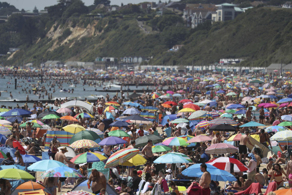 Crowds gather on the beach in Bournemouth as the UK experience a heat wave, in Bournemouth, England, Thursday, June 25, 2020. (Andrew Matthews/PA via AP)