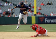 Minnesota Twins shortstop Jorge Polanco, top, leaps over Los Angeles Angels' Luis Rengifo after forcing him out at second base on a ground ball by Kole Calhoun during the fifth inning of a baseball game Thursday, May 23, 2019, in Anaheim, Calif. (AP Photo/Marcio Jose Sanchez)