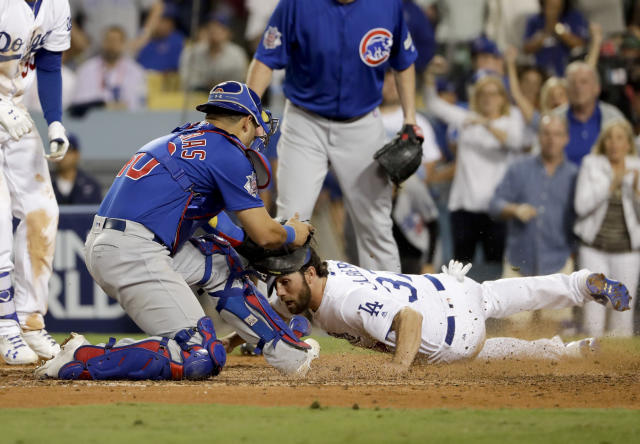 Dodgers' runner Charlie Culberson slides past Cubs catcher Willson Contreras during a controversial play in Game 1 the NLCS. (AP)