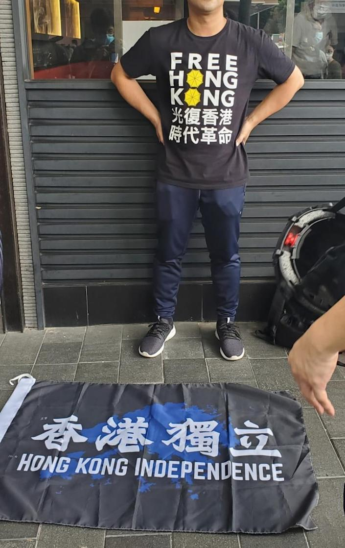 A man found in possession of a Hong Kong independence flag became the first person to be arrested under Beijing's new national security law - HK Police/Twitter